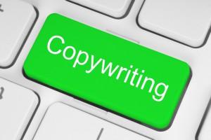 Green copywriting button on a white keyboard